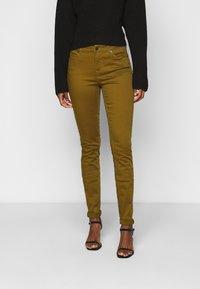 Vero Moda Tall - VMHOT SEVEN MR SLIM PUSH UP PANT - Trousers - fir green - 0