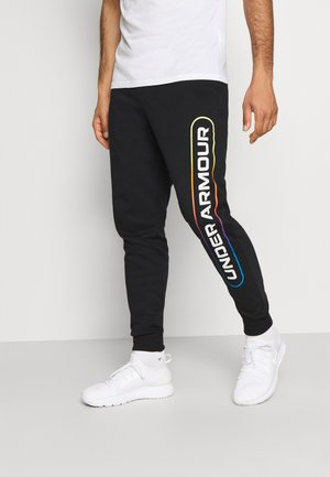 RIVAL LOCKERTAG - Tracksuit bottoms - black