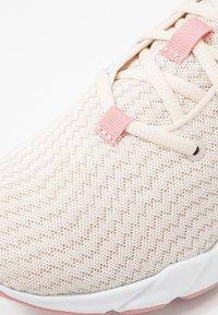 Puma - WEAVE XT SHIFT - Sports shoes - pastel parchment/white - 5