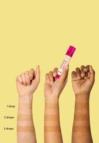Coco & Eve - SUNNY HONEY BRONZING FACE DROPS - Sun protection - medium glow - 6