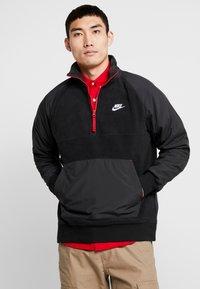 Nike Sportswear - WINTER - Fleecetrøjer - black/off noir/gym red/white - 0