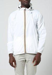 K-Way - CLAUDE 3.0 UNISEX  - Summer jacket - white - 1