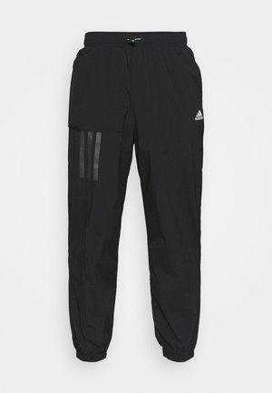 CITY - Teplákové kalhoty - black