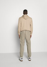 adidas Originals - SAMSTAG  - Tracksuit bottoms - clay