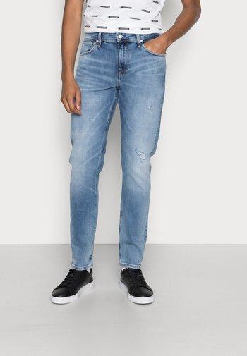 SLIM TAPER - Slim fit jeans - denim light