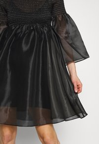 Who What Wear - THE SMOCKED ORGANZA DRESS - Cocktail dress / Party dress - black - 5