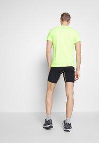 La Sportiva - FREEDOM TIGHT SHORT - Leggings - black/yellow - 2