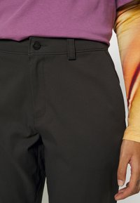 The North Face - CITY STANDARD ANKLE PANT - Chinos - black - 3