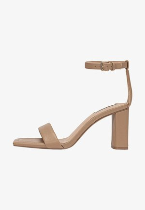 Varrelliset sandaalit - beige