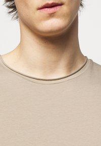 Filippa K - ROLL NECK TEE - Basic T-shirt - desert taupe - 6