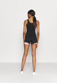 Smilodox - Sports shorts - black/pink - 2
