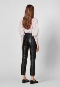 sandro - LEATH - Leather trousers - black - 2