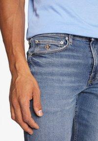 Calvin Klein Jeans - SLIM TAPER - Slim fit jeans - dark blue - 5