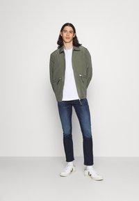 Calvin Klein Jeans - SLIM - Slim fit jeans - denim dark - 1