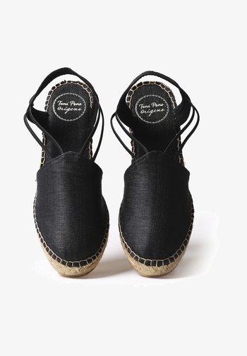 TURIA - Wedge sandals - black