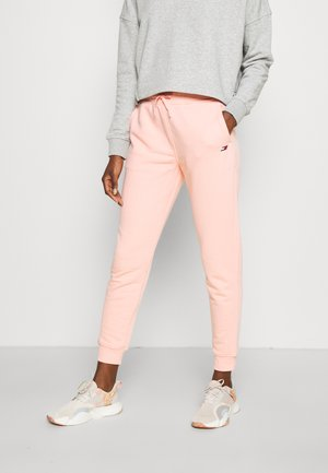 GRAPHIC PANT - Tracksuit bottoms - pink opal