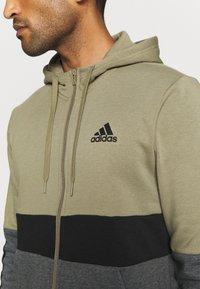 adidas Performance - COLORBLOCK FULL ZIP ESSENTIALS - Zip-up sweatshirt - orbit green/black - 5