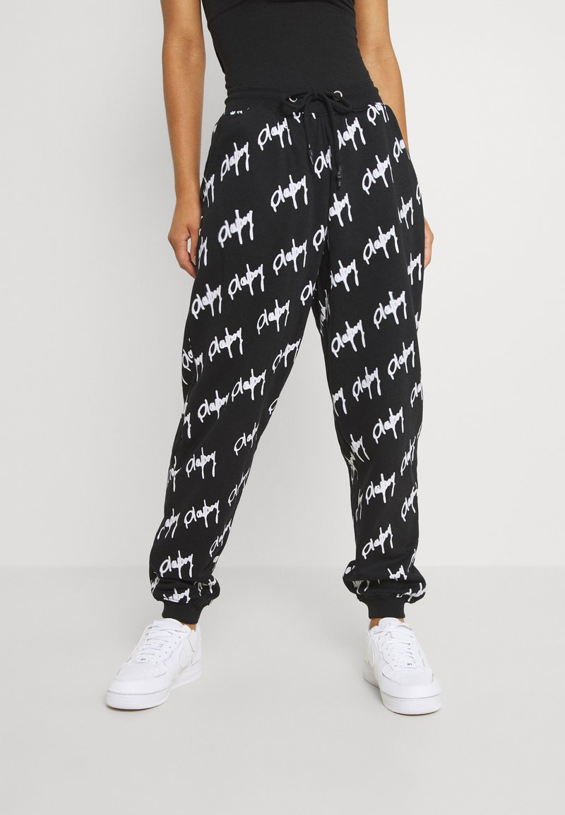 Missguided - PLAYBOY GRAFFIFTI OVERS - Tracksuit bottoms - black