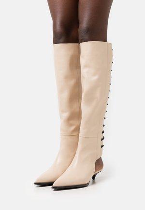 AVANNI - Lace-up boots - wood