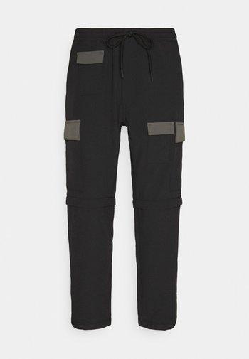 ZIP OFF - Cargo trousers - blacks
