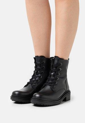 SAORY - Winter boots - black