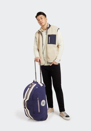 DEVIN ON WHEELS - Wheeled suitcase - galaxy blue block
