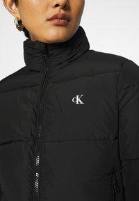 Calvin Klein Jeans - REPEATED LOGO PUFFER - Kurtka zimowa - black - 5