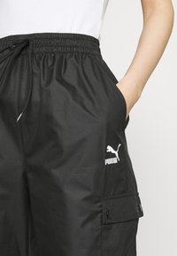 Puma - Tracksuit bottoms - black - 3