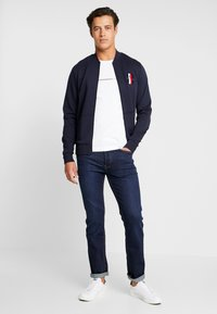 Tommy Hilfiger - FLEX LUXURY ARTWORK BASEBALL ZIP - Zip-up hoodie - blue - 1