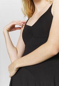 Bloch - ASYMMETRICAL HEM TANK DRESS - Jurken - black - 5