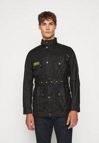 Barbour International - SLIM INTERNATIONAL WAX JACKET - Lehká bunda - black - 0