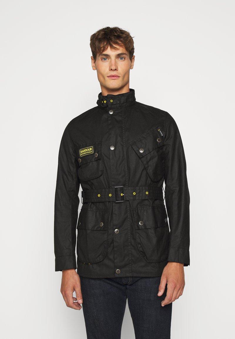 Barbour International - SLIM INTERNATIONAL WAX JACKET - Lehká bunda - black