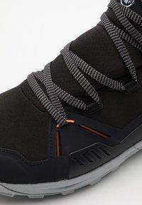 Mammut - SAENTIS PRO WP - Obuwie hikingowe - black/vibrant orange - 5