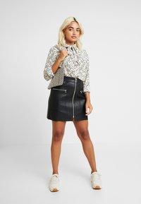 Vero Moda Petite - VMAFIA BOW - Button-down blouse - pistachio shell - 1