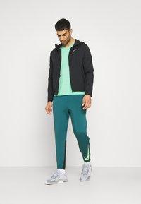 Nike Performance - MILER  - Basic T-shirt - green glow/reflective silver - 1