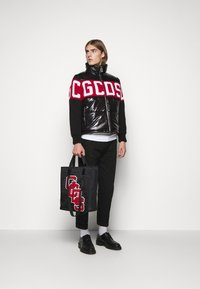 GCDS - LOGO MIX PUFFER - Winter jacket - black - 1