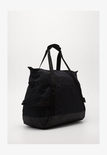 TEAM DUFF - Sports bag - black/black/white