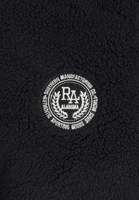 Russell Athletic Eagle R - BERNARD MODERN HALF ZIP JACKET UNISEX - Summer jacket - black - 2
