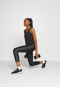 Under Armour - ANKLE CROP - Legging - black