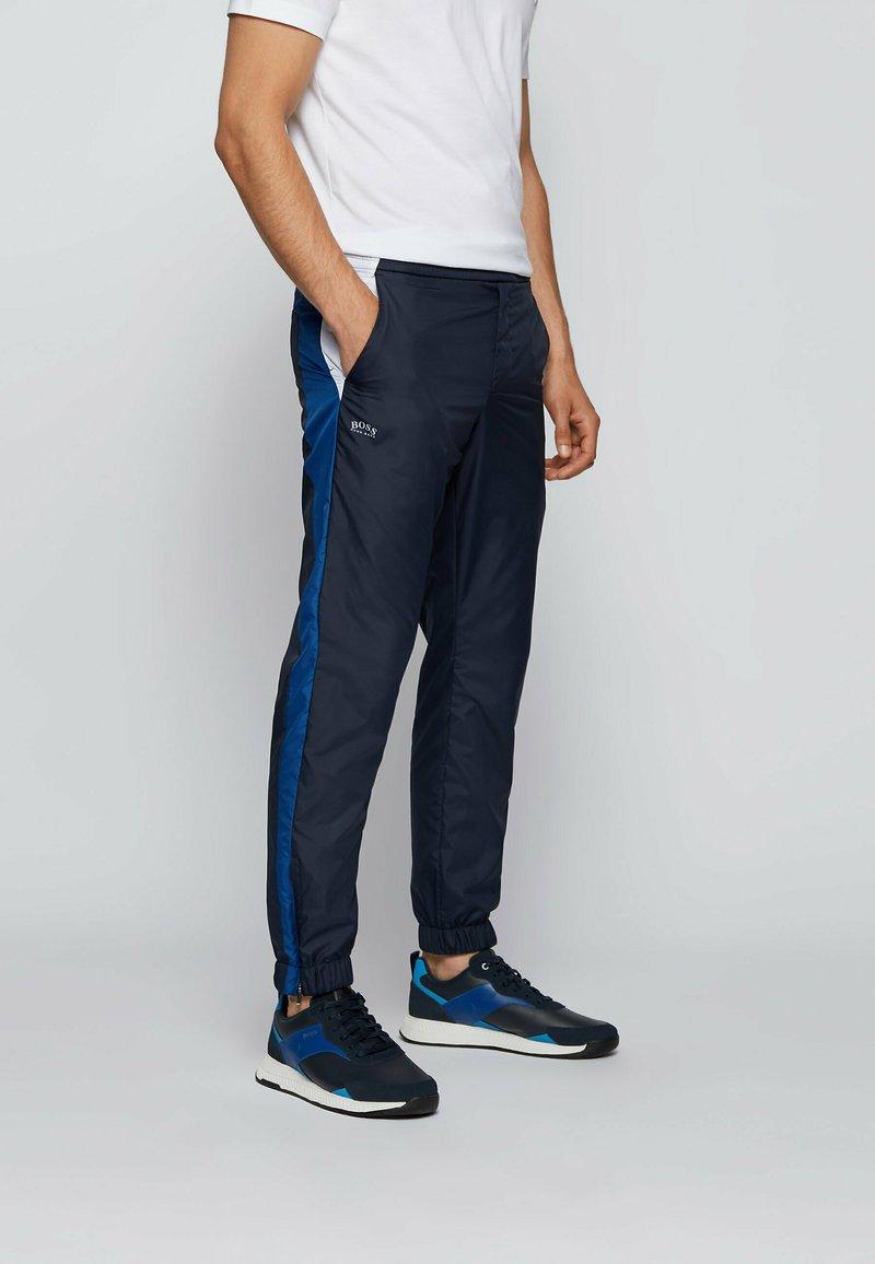 BOSS - Tracksuit bottoms - dark blue