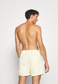 Jack & Jones - JJIARUBA SWIM  SHORTS - Swimming shorts - flan - 1