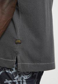 G-Star - REFLECTIVE LOGO LOOSE OD R T S\S - T-shirt z nadrukiem - compact black - 4