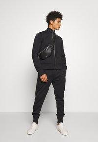Joseph - NEW NEOPRENE TRACKSUIT - Spodnie treningowe - black - 1