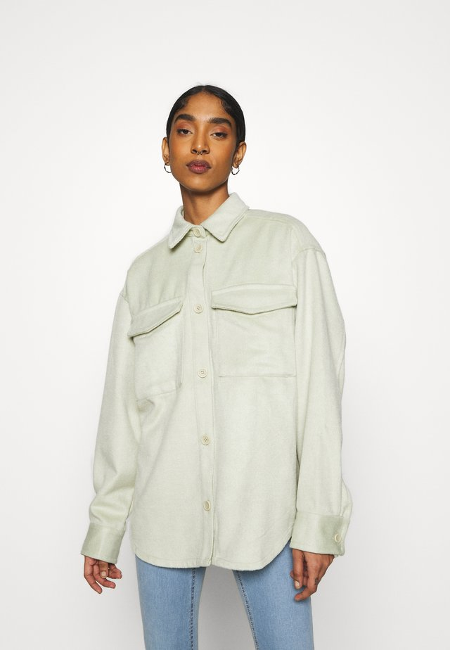 BENNIE - Button-down blouse - green dusty light