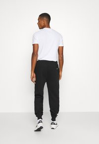 Lacoste LIVE - Tracksuit bottoms - black - 2