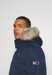Tommy Jeans - TECH BOMBER UNISEX - Winter jacket - twilight navy - 6