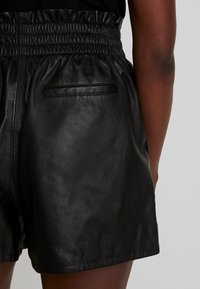 Ibana - FEAST - Leather trousers - black - 4