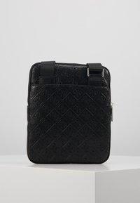 Guess - DAN LOGO MINI FLAT CROSSBODY - Across body bag - black - 3