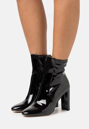 AURELLANE - Classic ankle boots - black