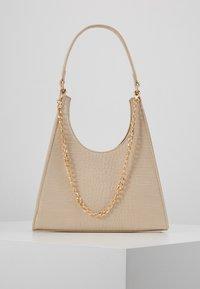 PCSTELLA CROSS BODY KEY - Handbag - ivory cream/gold